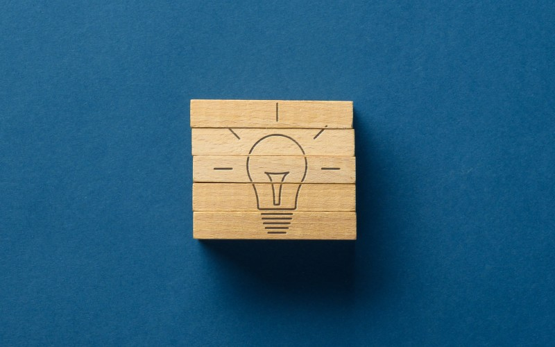 Wooden cube with light bulb on it