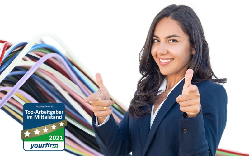 Woman with thumbs up and cable in the background